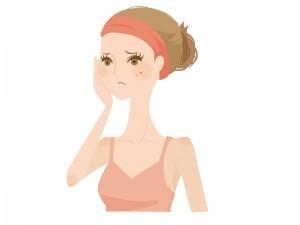 肌荒れを気にする女性のイラスト-300x225