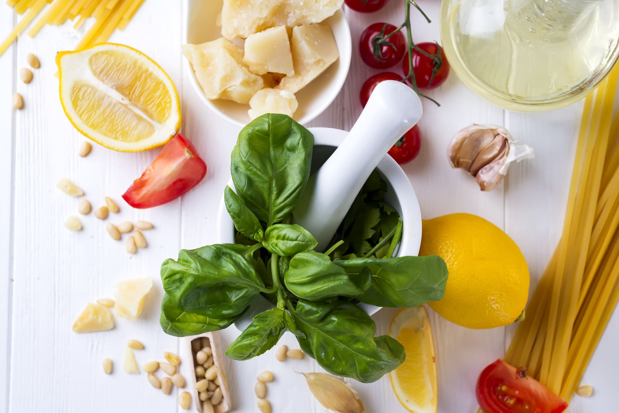 ingredients for cooking pasta on a stone background, top view. Flat lay copy space